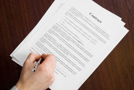 Businessman signing contract on the table Stock Photo