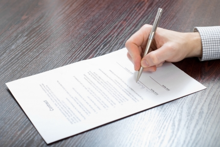 information analysis: Signing contract by businessman Stock Photo