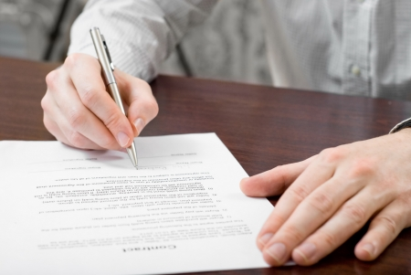 Signing contract by businessman Stock Photo