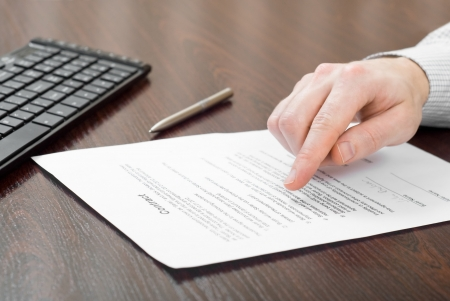 Business man reading contract