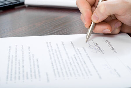 Close up shoot of signing contract by businessmen
