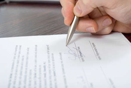 Close up shoot of signing some document Stock Photo