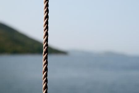 Hemp rope in front of lake landscape Reklamní fotografie