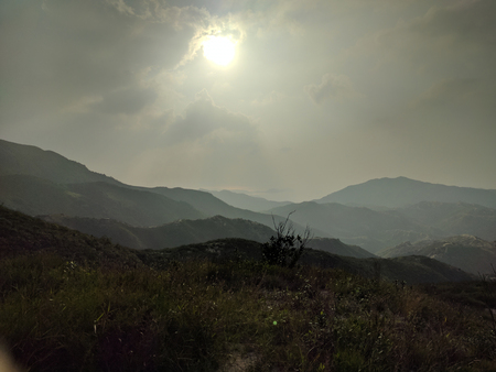 Sunset landscape in haze