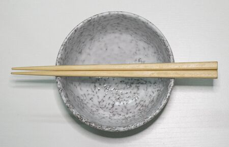 Empty bowl with a pair of chopsticks