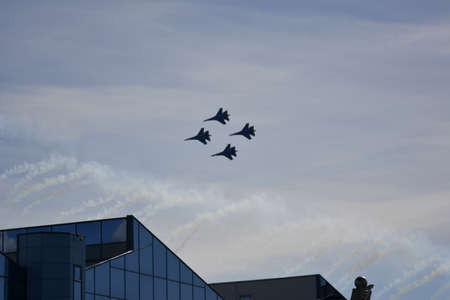 A performance by a group of russian warplanes in the sky at the parade