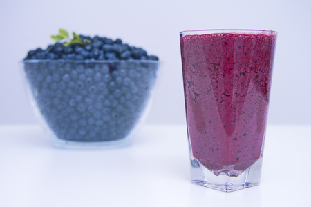 wildberry: big cup of bilberry fresh juice Stock Photo