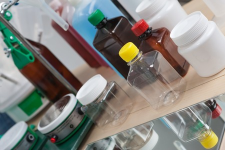 viscosity: The laboratory table with devices, vessels and small bottles Stock Photo