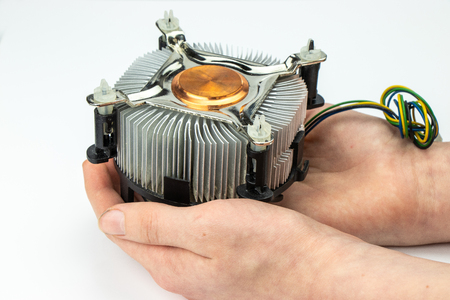 Processor cooler in men's hands on a white background.