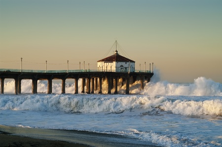 Large Surf Crashing into Pier photo
