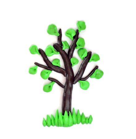 Plasticine tree which is represented on a white background. Stock Photo