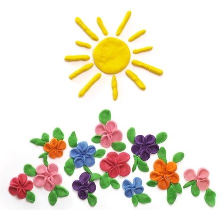 plasticine: The sun and flowers which are moulded from plasticine
