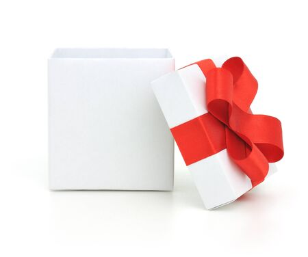 christmas present box: Open empty gift box and red bow. Isolated.