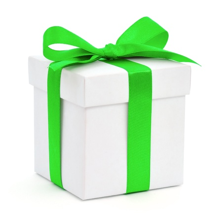 White gift box with a green bow on white background
