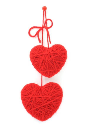 strings: two hearts made of red wool yarn