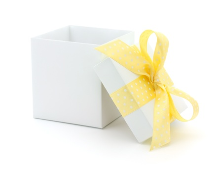 yellow ribbon: Open empty gift box and yellow bow. Isolated. Stock Photo