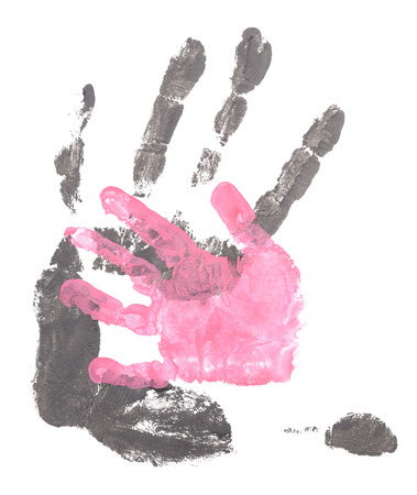 Men and child handprints made from black and pink acrylic paint on white paper. photo