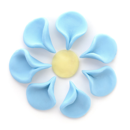 child's play clay: Plasticine flower isolated on a white background