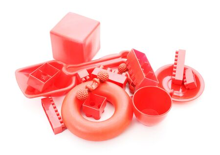 plastic toys: Red plastic toys on a white background Stock Photo