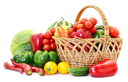 green vegetables: Variety of raw vegetables in wicker basket isolated on white. Stock Photo