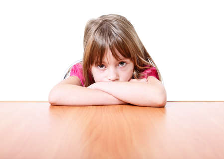 petite fille triste: Sad little girl isolated on white background.