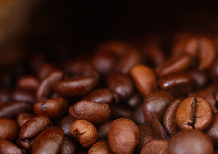 Coffee beans. Dark  with copy space, close-up.