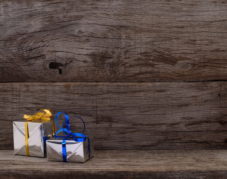 Gift boxes on wooden board  with space for text.