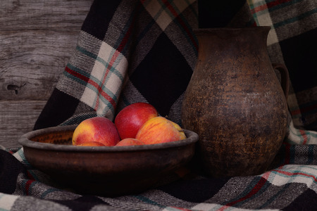 Classical still life with apples and jug.