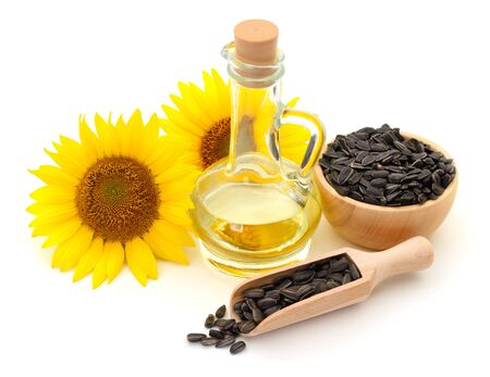 Sunflower oil, seeds and flower isolated on white background. Standard-Bild - 133908762