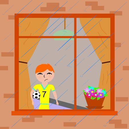 boy near the window watching the rain