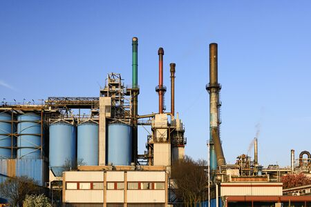 Petrochemical industrial plant power station at sunset, close up of a factory building,
