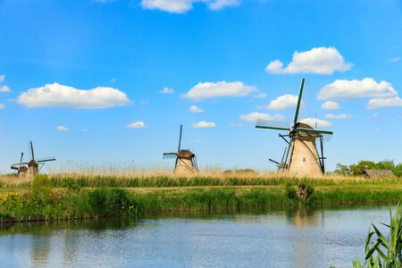 Old windmills on dutch landscape, Kinderdijk is a village in the municipality of Molenlanden, in the province of South Holland, Netherlands