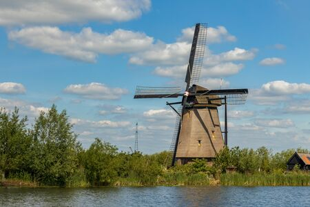 Old windmill on dutch landscape, Kinderdijk is a village in the municipality of Molenlanden, in the province of South Holland, Netherlands