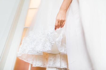 'getting ready': Brides dress and hand on wedding day. Getting ready