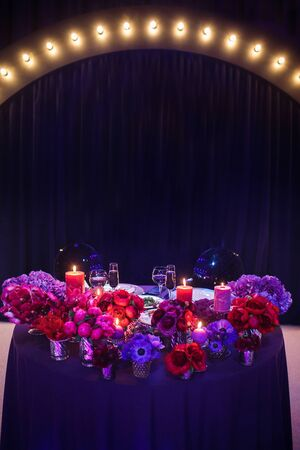 Candles and beautiful flowers on the wedding table.