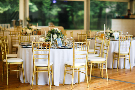 Tables sets for wedding or another catered event dinner. Stock Photo - 92493637