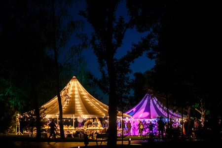 Colorful wedding tents at night. Wedding day.