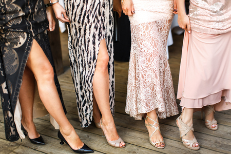 Closeup of legs of women standing on the floor. Stock fotó