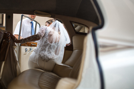 The bride and groom go from church to car.