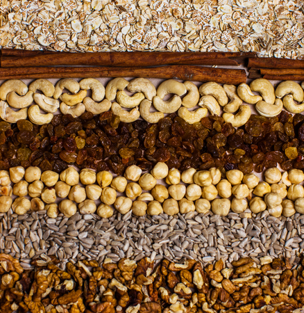 Rows of raw organic nuts and oatmeal