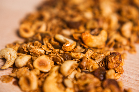 Tasty homemade granola on wooden table