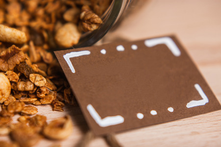 Tasty homemade granola on wooden table with card Stock fotó