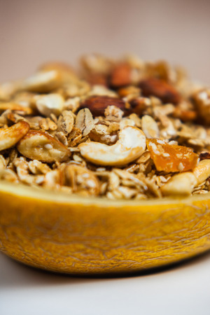 Muesli in a plate of melon