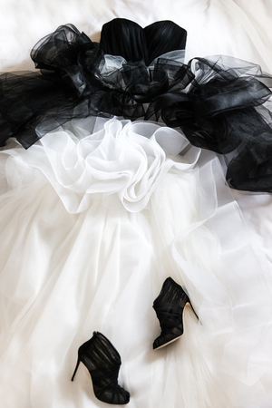 Black wedding shoes and wedding dress on the bad Stock fotó