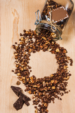 Homemade granola in glass jar on wooden background Stock fotó