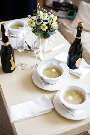 Ceramic tableware on the table and and and champagne