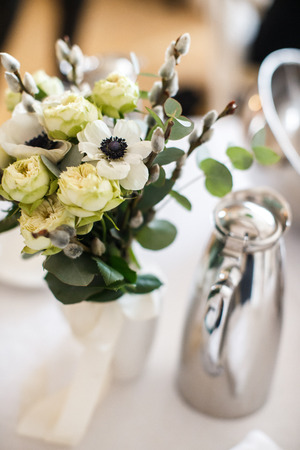 Bouquet flower in vase on the wedding table.