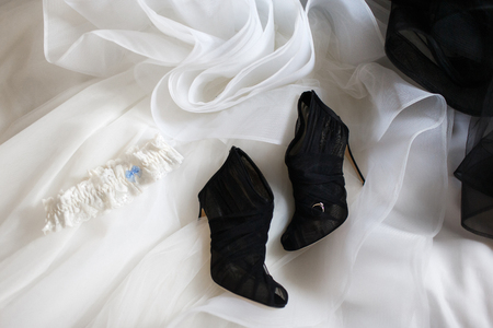 Wedding ring on the black wedding shoes Stock fotó