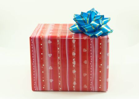 Red gift box with blue bow Stock Photo