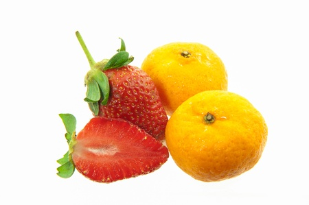 Strawberries and orange on a white background